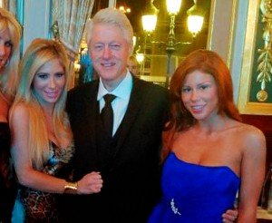 Clinton poses with porn stars