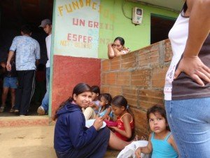 Children displaced or fatherless by FARC violence get fed at a Medellin Colombia soup kitchen
